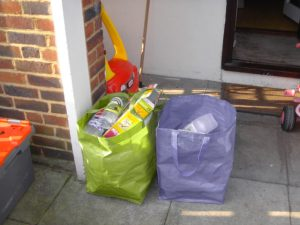 My two bags of recyclables waiting to be picked up.