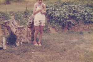 A young me in front of the garden